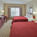 Country-Inn-and-Suites-Orlando-bedroom